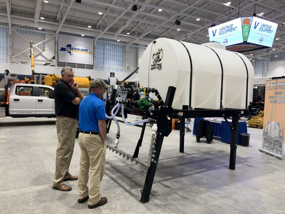 NYS Highway and Public Expo attendees examine a de-icing tank.