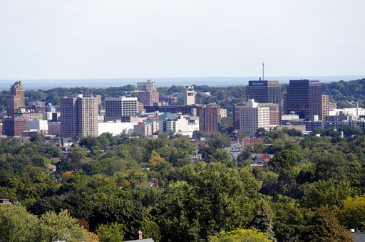 Clear skies over the skyline in the city of Syracuse. According to COMPSTAT reports from the Syracuse Police Department, North Syracuse is considerably more dangerous than East Syracuse and South Syracuse. (AP Photo/Mike Groll, File)