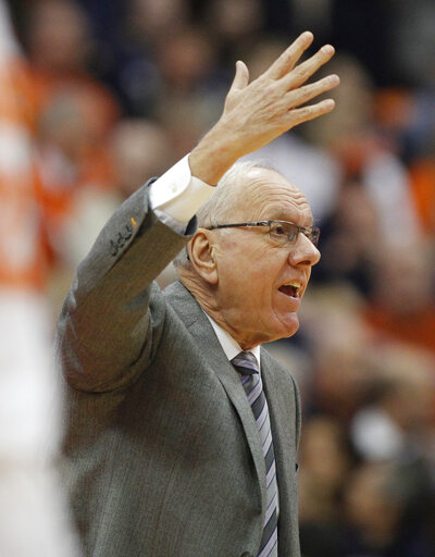 Syracuse head coach Jim Boeheim yells to his players during the first half of an NCAA college basketball game against Louisville in Syracuse, N.Y., Wednesday, Feb. 20, 2019.