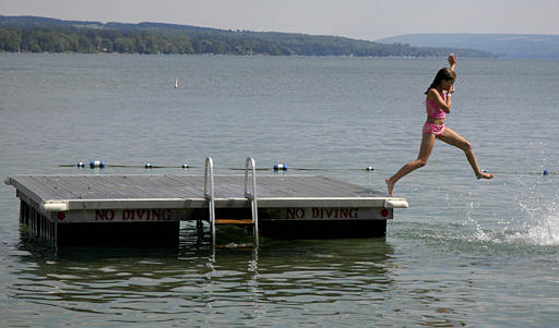 Taylor Ennist jumps into Skaneateles Lake in Skaneateles, N.Y., Friday, July 29, 2005.