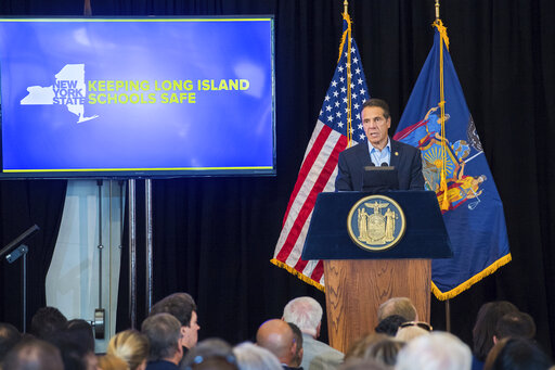 In this Sept.18, 2019 photo provided by the Office of New York Governor Andrew M. Cuomo, Gov. Cuomo launches Statewide Education Campaign on New Red Flag Law at a conference in Farmingdale, N.Y. The first of three conferences is meant to educate teachers, school administrators and parent representatives on New York's new gun safety law. (Darren McGee/Office of New York Governor Andrew M. Cuomo via AP)