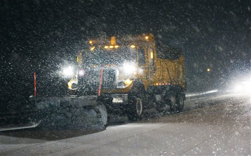 Snow plow clearing a road