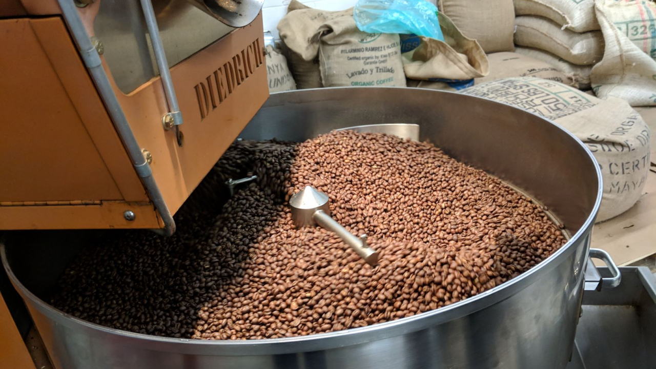 Beans are dried in the roaster.