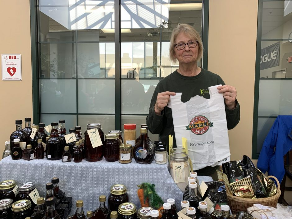 """Vendor Barbara Hamlin from Pied Piper Maple Farm holds a plastic bag while she said: """"when these are gone, I'm not buying any more!"""