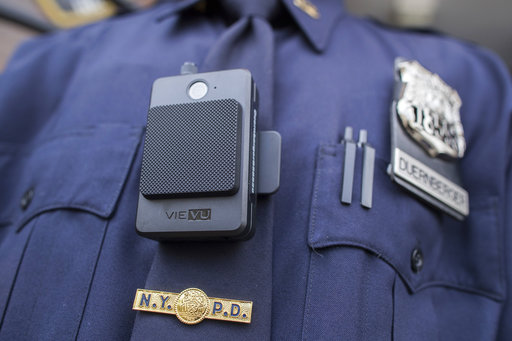 Body camera mounted on police officer's chest.