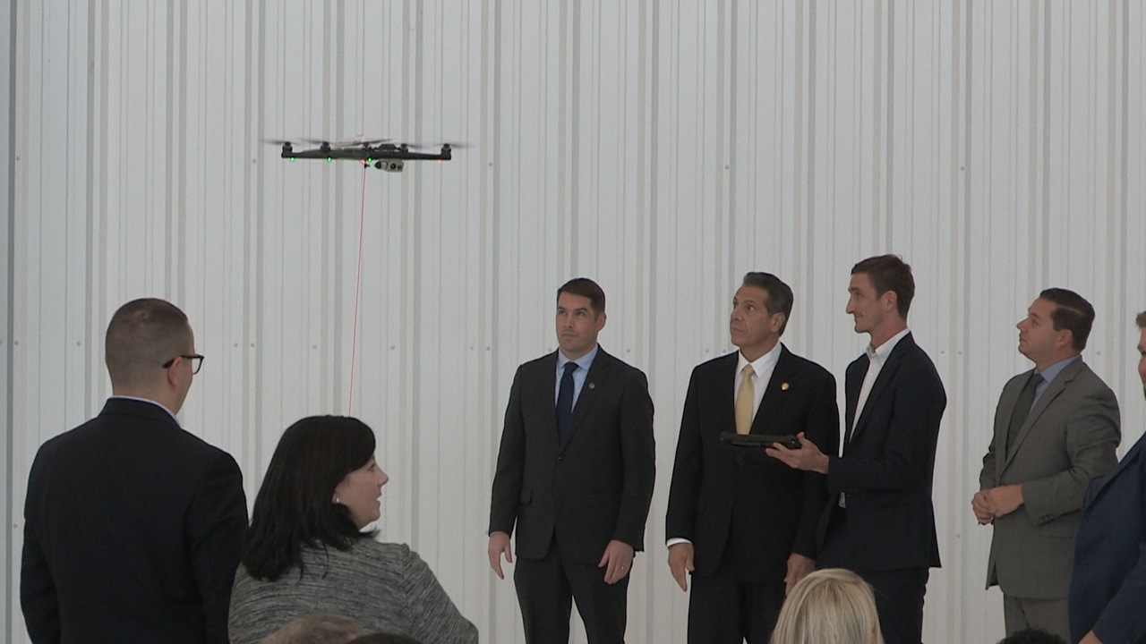 Gov. Cuomo and other people watching a drone.