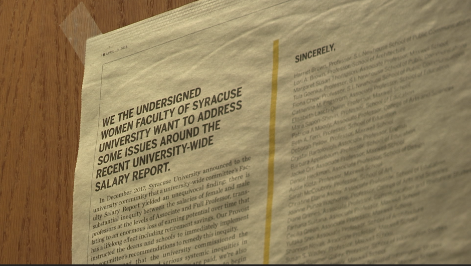 A close-up of the Syracuse University student-run newspaper, The Daily Orange, on the wooden door to Professor Audie Klotz's office.