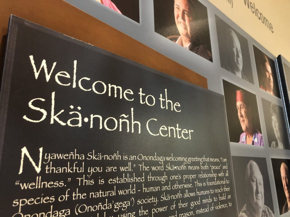 "A sign at the front of the center reads, ""Welcome to the Skä•noñh Center."""
