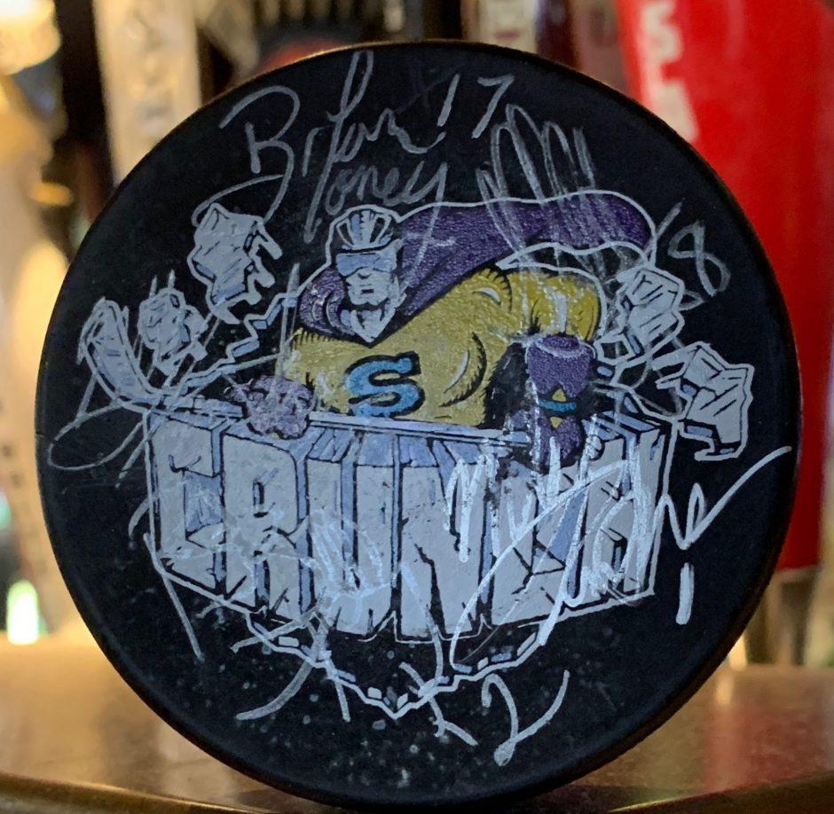 A black Syracuse Crunch hockey punk