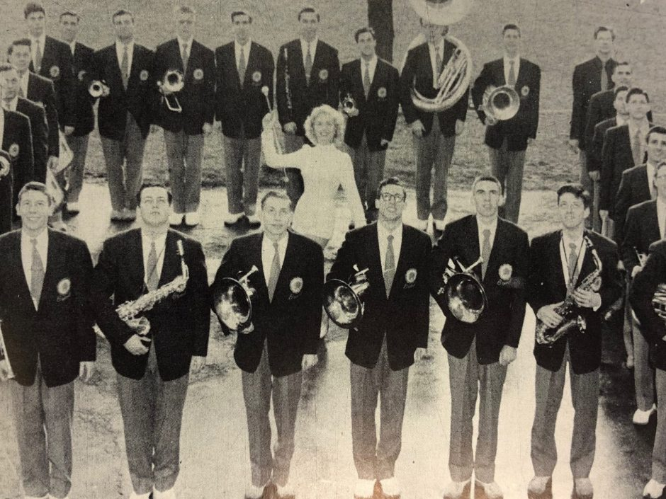In 1953, Dottie Grover poses with the Syracuse University band: The 100 Men and a Girl