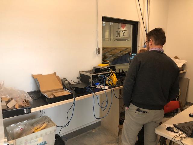 Richard Bellamy is setting up audio equipment.