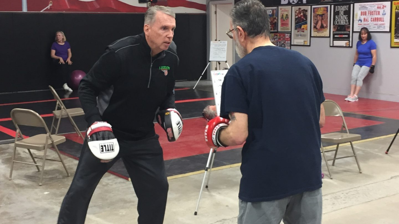 A Parkinson's patient takes a boxing class to fight the disease.
