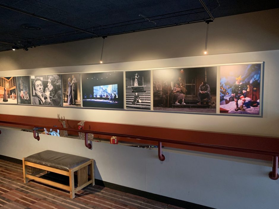 Image of several screenshots of Syracuse Stage's history taken from the Stage's second floor.