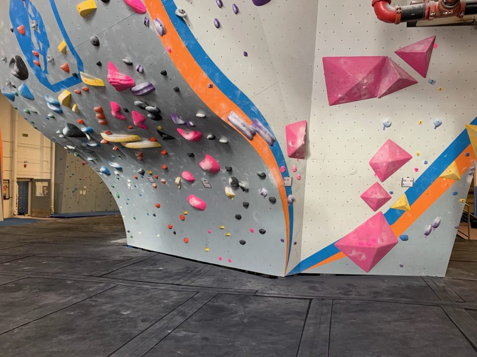 gray rock climbing wall, black floor