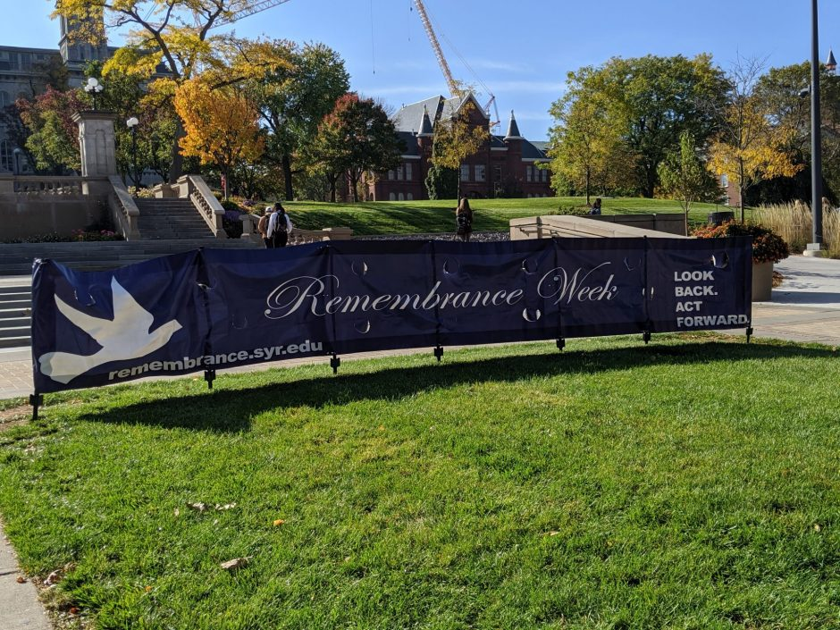 Signs of Remembrance Week can be seen around Syracuse University's campus.