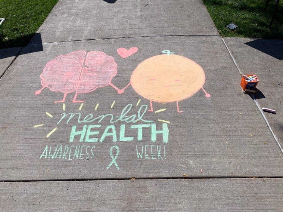 Mental Health Awareness messages written in chalk on the quad sidewalk.