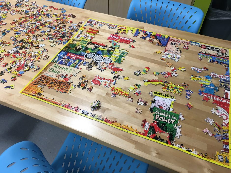 Jigsaw puzzle on table.
