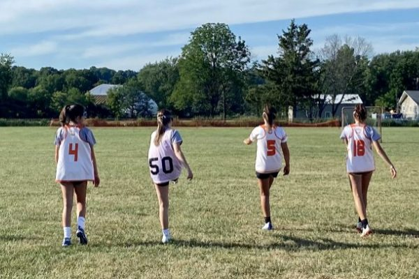 Orange Crush lacrosse club players practice twice a week at a field in Warners, NY.