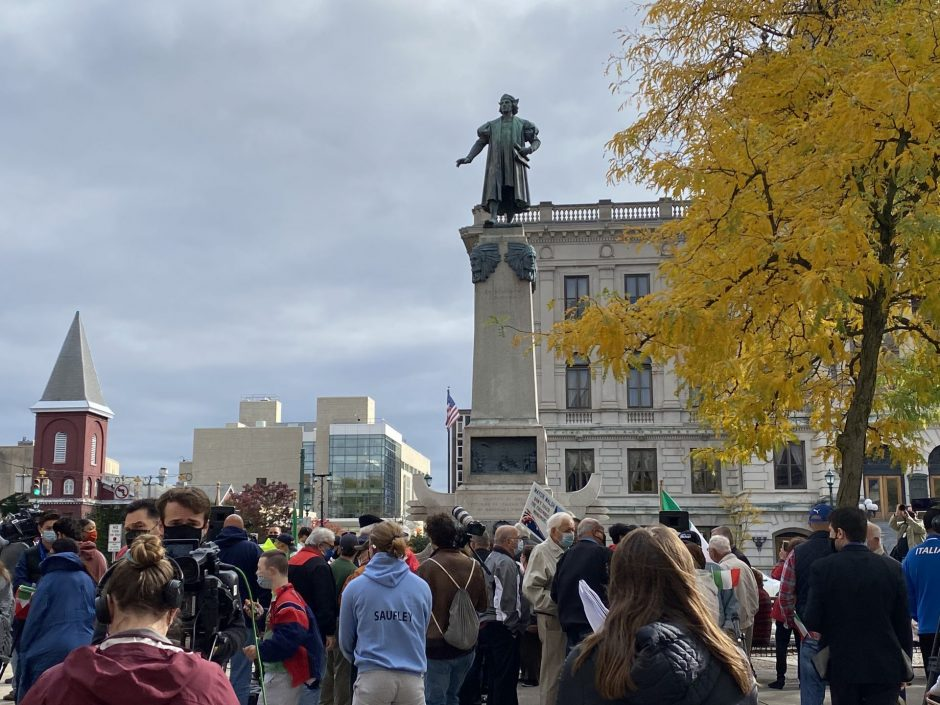 People gathering in front of Columbus statue