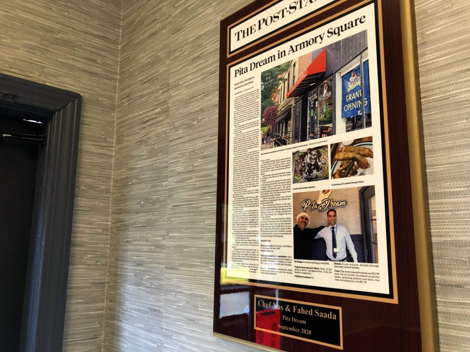 The first restaurant review of Pita Dream hangs framed in the restaurant's entryway.