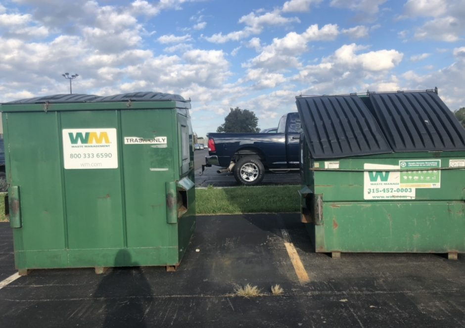 Trash and recyclable dumpsters.