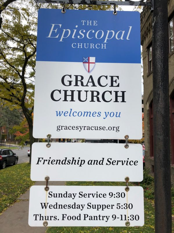 Grace Church sign with information on church services and food pantry times