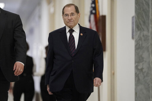 Jerrold Nadler walks through Capitol Jill surrounded by people