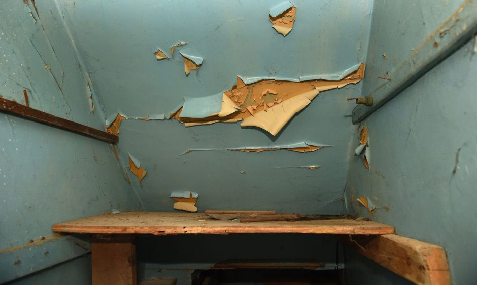 A Syracuse home with old paint beginning to fall of the walls, due to poor housekeeping and construction.
