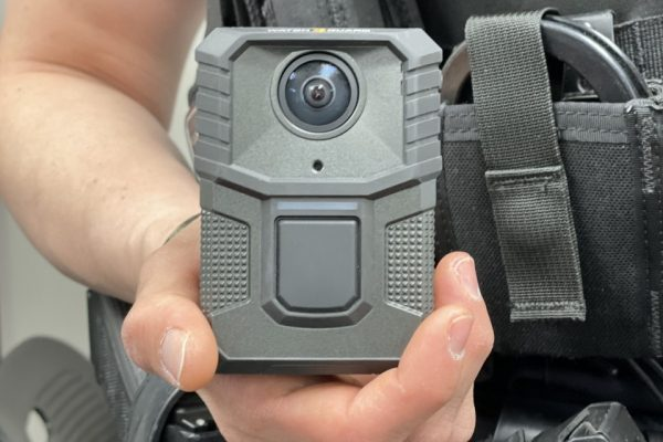 A body camera being held by an officer. Ten body cameras were given to the 18 police officers at the Cicero Police Department in early to help improve transparency between the police and the public.