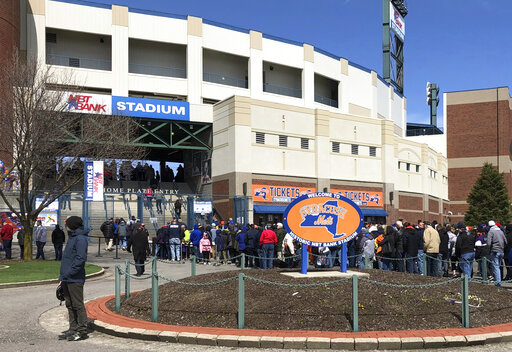 Fans lined up outside NBT Bank Stadium in Syracuse, N.Y., Thursday, April 4, 2019, as Tim Tebow is expected to play in the opening-day minor league baseball game with the Triple-A Syracuse Mets. The former Heisman Trophy winner and NFL quarterback is trying to make it to the major leagues with the New York Mets organization. (AP Photo/John Kekis)