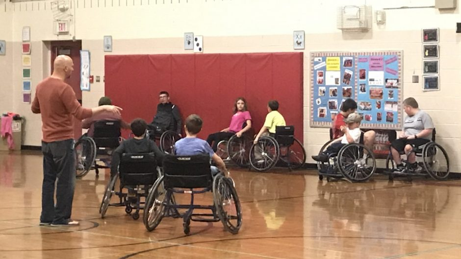 Picture of kids playing wheelchair basketball