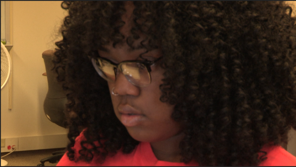 Nicole Graine, who graduated from Upward Bound in 2018, focuses on an assignment for school.