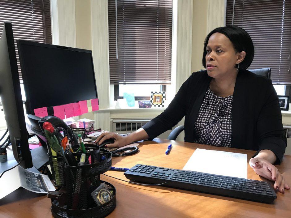Syracuse Deputy Mayor Sharon Owens sits at her desk