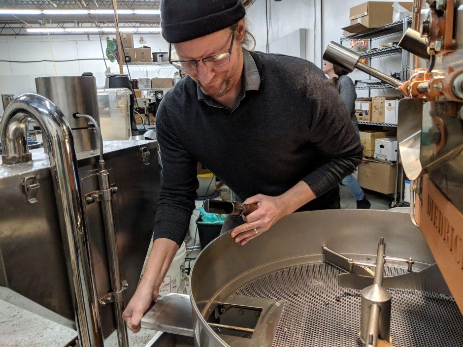 Graham Reynolds adjusts the coffee roaster.