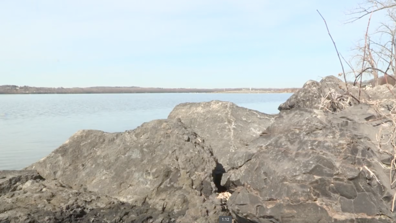 The sun shines bright on rocks lining the shore of Onondaga Lake Park on one of the first spring days of the year.