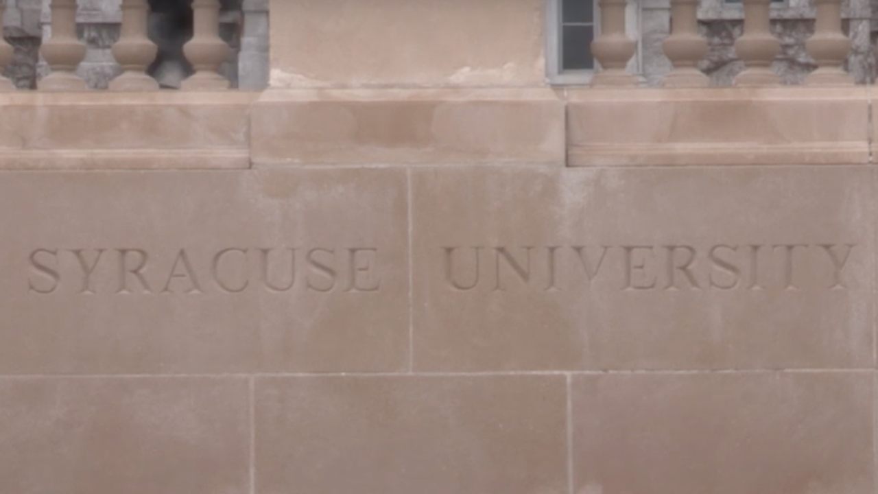 Syracuse University sign in front of the Hall of Languages