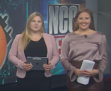 Mornings on the Hill anchor team stands in front of plasma screen