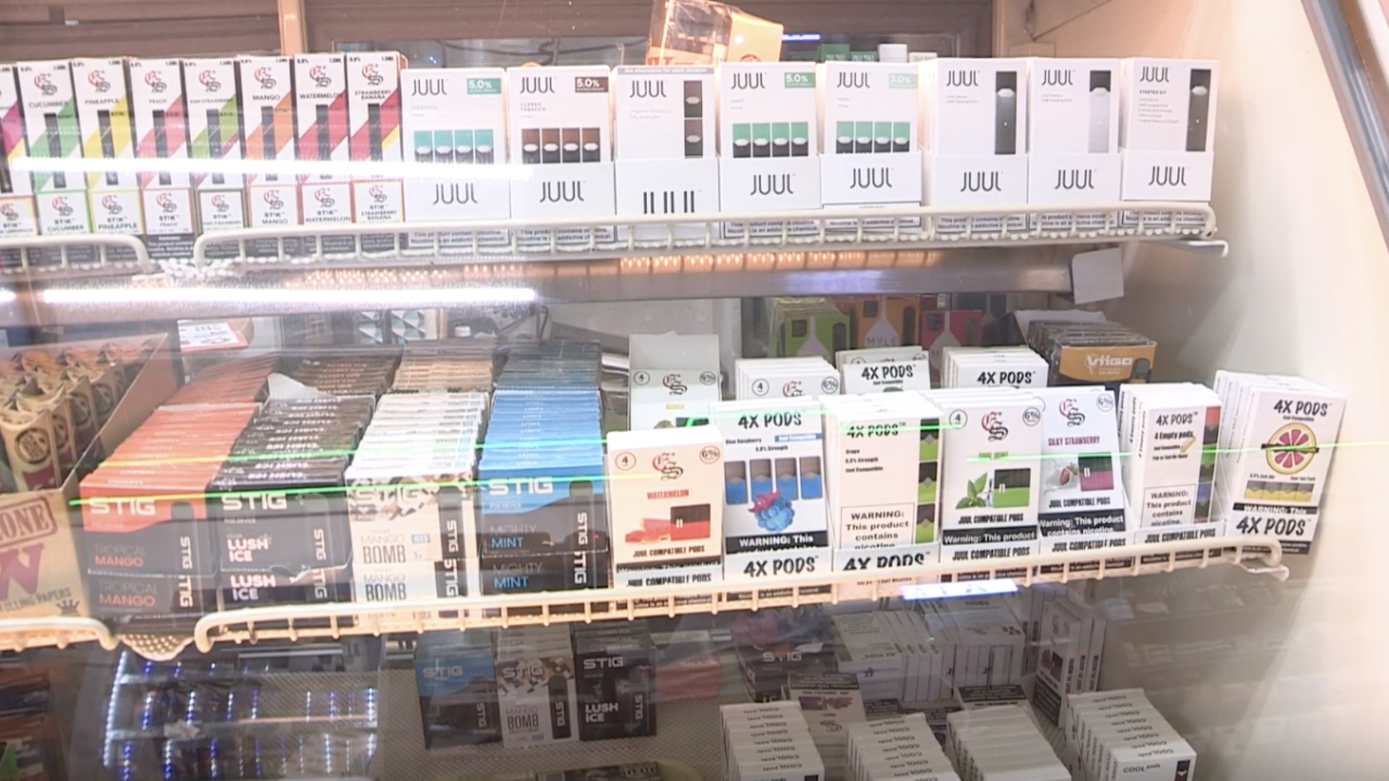 A shelf of juul pods offered in different flavors in a convenience store