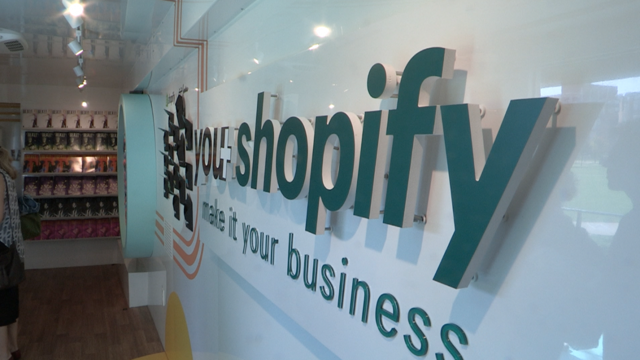 Shopify logo sign inside tour bus.