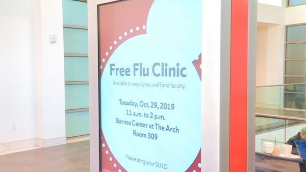 A sign at the Barnes Center promotes its free flu vaccine clinic.
