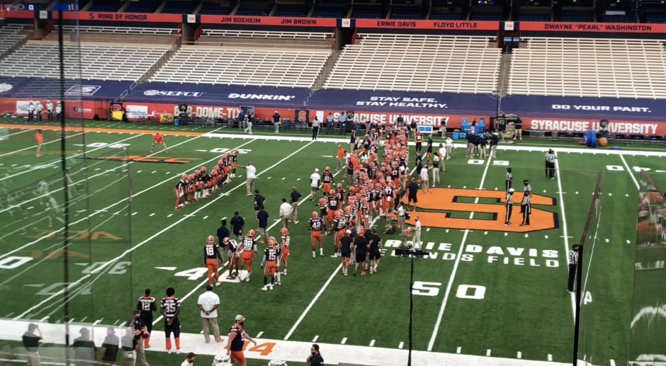 SU Football warming up in the Carrier Dome.