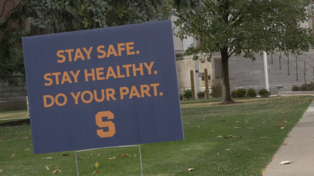 """A sign in the ground on the Syracuse University campus says """"Stay safe. Stay healthy. Do your part."""""""