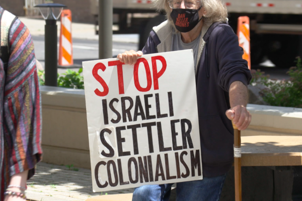 """Protest sign says """"Stop Israeli Settler Colonialism"""""""