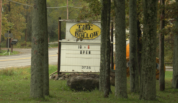 This is a picture of the Pumpkin Hollow sign in Marcellus, New York, a popular spot for Central New York families to enjoy fall activities.