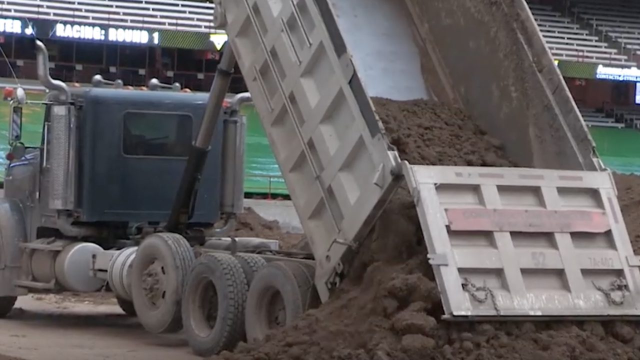 More than 130 truck loads of dirt had been dumped onto the Carrier Dome floor as of Wednesday afternoon.