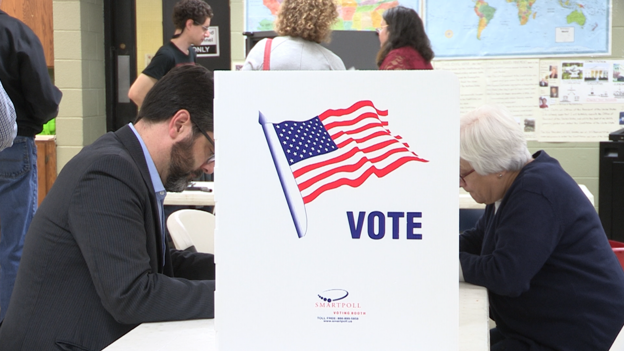 Two Onondaga County voters cast early ballots.