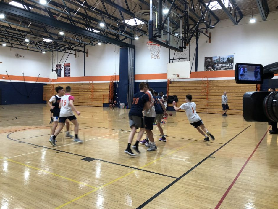 Solvay Boys' Basketball team running plays during practice