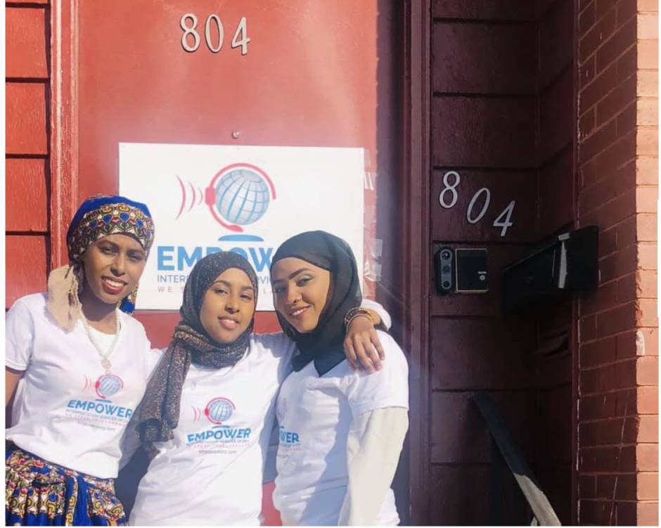 Khadijo Abdulkadir, Fartun Abdulkadir, and Farhyia Omar standing outside of Empower Interpretation Services of CNY.