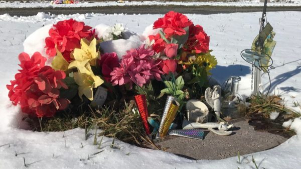 Flowers surrounding a tombstone at the Onondaga County Veterans Cemetery.