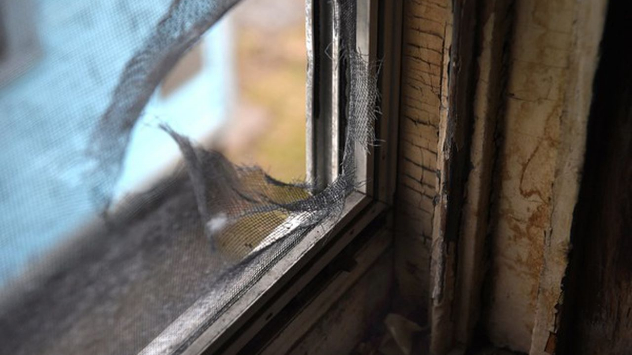 A broken window in a Syracuse city home. Many homes constructed prior to 1980 are now unfit to live in due to poor construction and lead paint problems.
